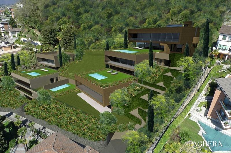على بحيرة لوجانو، خمس ڤيلات فاخرة تحيط بها الخضرة.  - المناطق السياحية السكنية